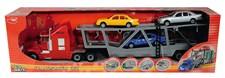 Autonkuljetusrekka (punainen) kuljetusperävaunulla ja kolmella autolla